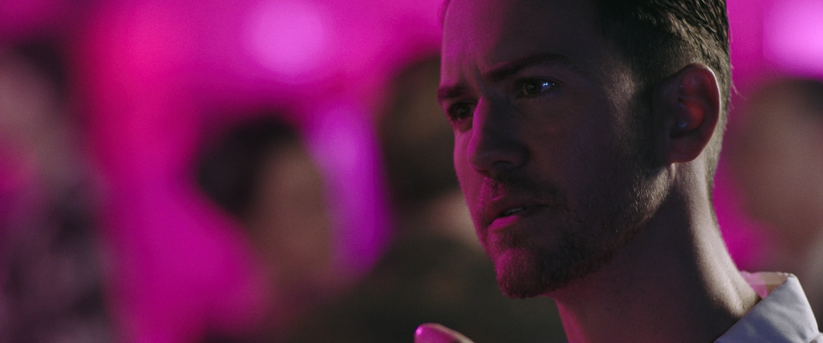 A frame grab from Perception, now available to watch online, showing star Wes Ramsey in the films signature pink light